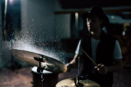 Repetition of rock music band. Drummer behind the drum set. Water splashes on cymbal. Archivio Fotografico