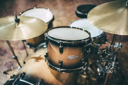 Cropped image of drum set. Closeup of drum kit. Bass drum, floor tom, snare drum, hanging/rack toms, hi-hat, crash cymbal.