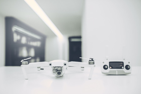 Light white store with modern devices. Quadcopters, glasses of virtual reality, camera with stabilization system, 4K video. Stock Photo