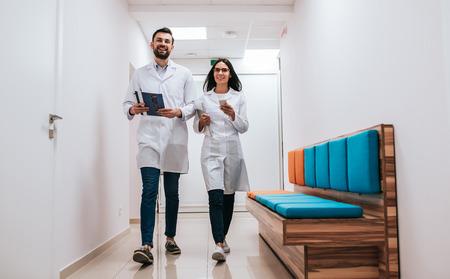 Two doctors are walking in the corridor of modern clinic. 版權商用圖片