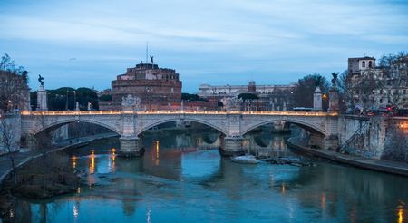 View of Castel Sant`Angelo from across the river Tiber in an evening soothing light.