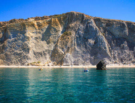 Beautiful face of the Ponza Island seen from the crystal clear blue water of Chiaia di Luna