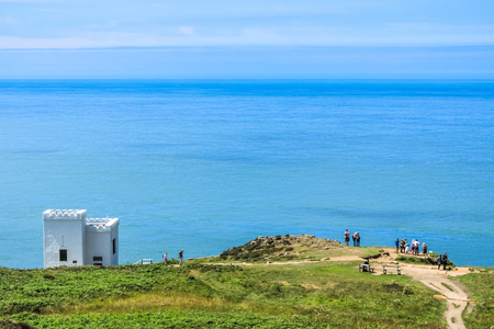 Tourists at South Stack Anglesey Wales And sea landscape