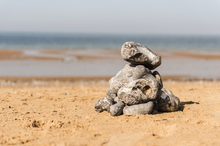 Pile of pebbles on a sandy beach