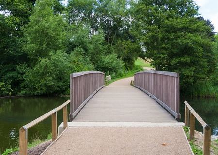 Modern footbridge over a river Stock Photo