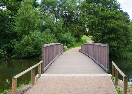 footbridge: Modern footbridge over a river Stock Photo