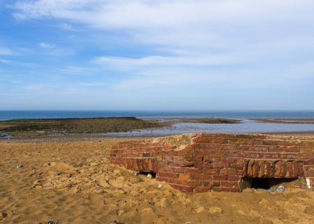 WW2 Bunker partially buried on a Sandy Beach in Norfolk Stock Photo