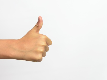 Young boys hand outstretched with thumbs up Stock Photo