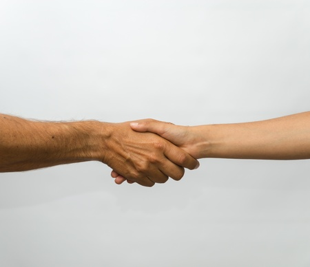 Handshake - two hand is hand shake jesture against a white background Stock Photo - 15351036