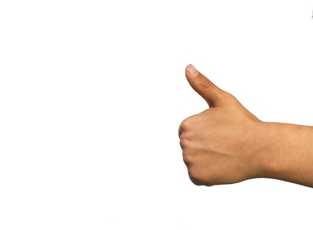 Young womans hand in a thumbs up jesture against a white background Stock Photo