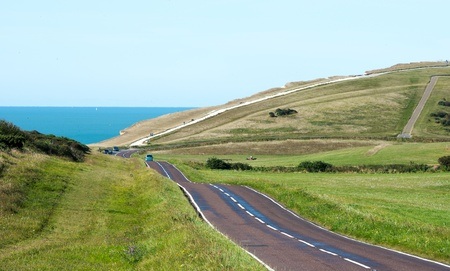Country Road Leading to the Coast through rolling hills photo