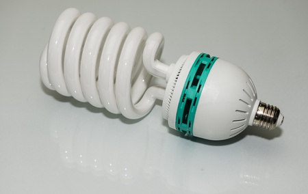 Large Photographic Low Energy Lightbulb on white background photo
