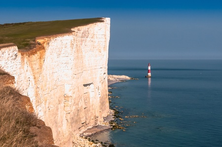 View of beachy head lighthouse and seven sisters from beachy head cliffs photo