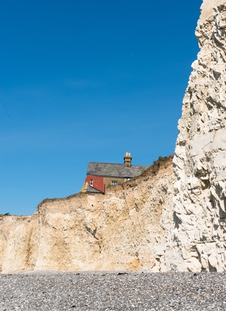 Houses close to cliff edge due to coastal erosion