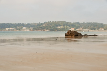 wide sandy beach in a quiet bay on Jersey, Channel Island UK. Stock Photo