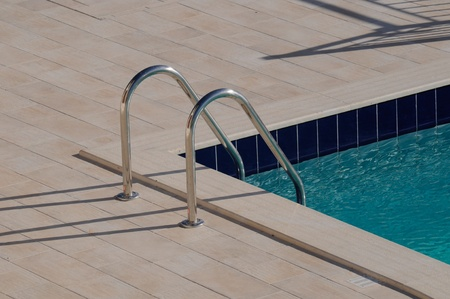 Swimming pool steps for an outdoor pool with luxury pation area