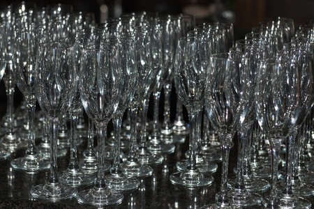 Many wine glasses on a bar