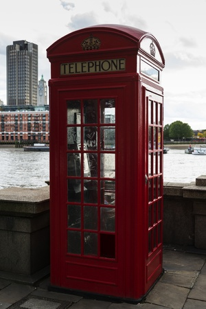 phonebox: Traditional red telephone box by the river thames