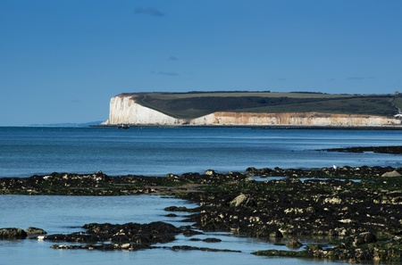 seven sisters: View over beach rocks to seven sisters coastline cliffs Stock Photo