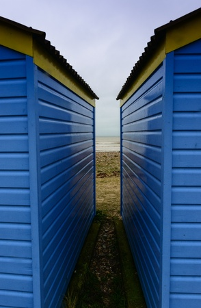 symetry: Blue and Yellow Beach Huts symetrical