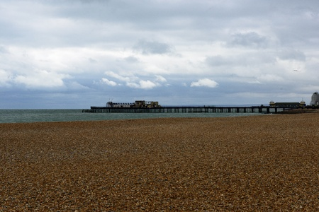 hastings: Pebble beach towards the wreck of Hastings Pier after the fire
