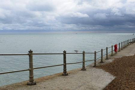 hastings: White railings on Hastings Seafront on a cloudy day