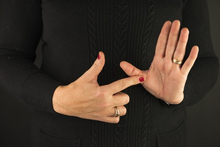 Woman Demonstrating Sign Language letter A
