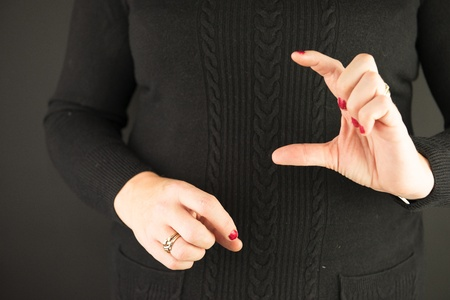 Woman Demonstrating Sign Language letter C