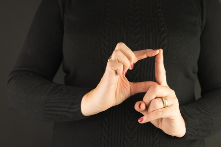 Woman Demonstrating Sign Language letter D