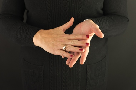 Woman Demonstrating Sign Language letter H