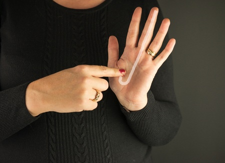 Woman Demonstrating Sign Language letter J Stock Photo