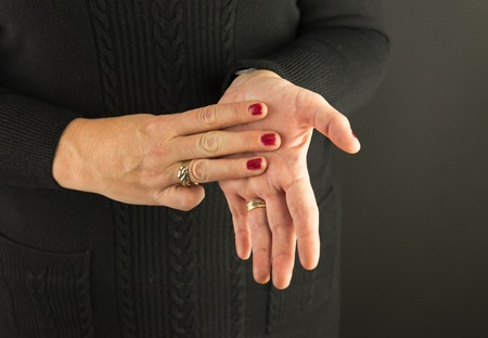 Woman Demonstrating Sign Language letter M Stock Photo