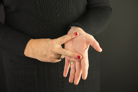 Woman Demonstrating Sign Language letter V Stock Photo