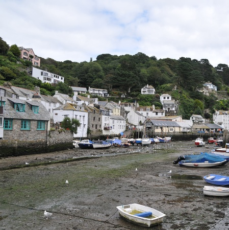 beached: Polperro harbour with the tide out and boats beached