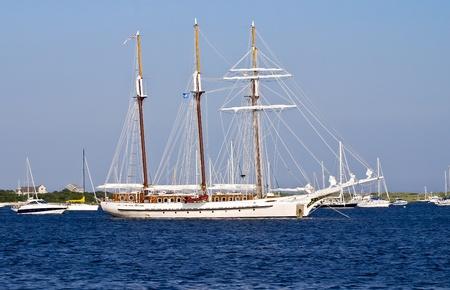 schooner: a beautiful three mast schooner anchored at bay