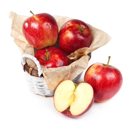 fresh red apples in the basket photo