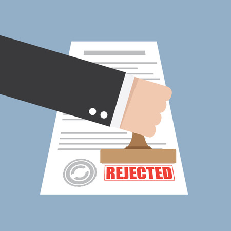 qualify: Rejected stamp in hand businessman