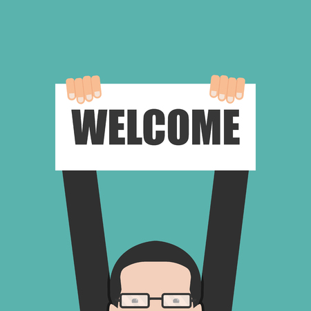 Businessman holding welcome banner