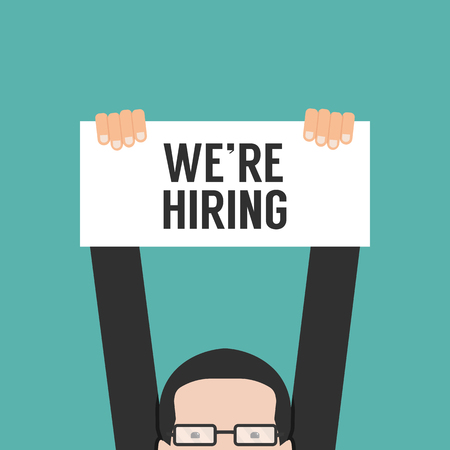 Hand holding we are hiring Vectores