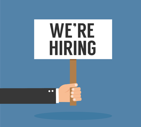 Hand holding signboard - We Are Hiring