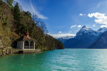 montreux: Mountains at lake Lucern and Village Fountain. View from boot, Switzerland