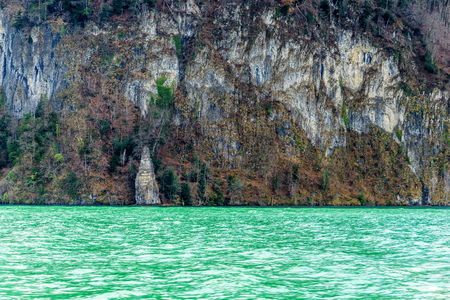Mountains at lake Lucern and Village Brunnen. View from boot, Switzerland