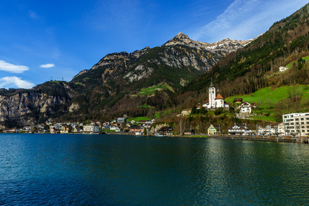Mountains at lake Lucern and Village Fountain. View from boot, Switzerland