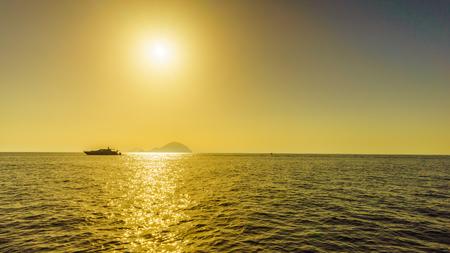 filicudi: Sunset at Pollara (Salina) looking towards ships and Filicudi and Alicudi, Aeolian islands Sicily