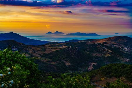 megaliths: Beautiful sunset from Montalbano Elicona, view of Aeolian Islands, Sicily Italy. Stock Photo