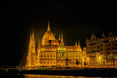 The Hungarian Parliament Building is the seat of the National Assembly of Hungary, one of Europes oldest legislative buildings, a notable landmark of Budapest. Night-view with Danube river. Stock Photo