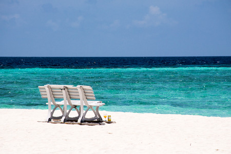 peacefully: Bench at the beach