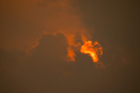Sun behind clouds Stockfoto