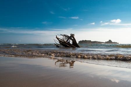 Sandy beach, sea and clouds