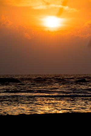 Sunset over the sea with sandy beach